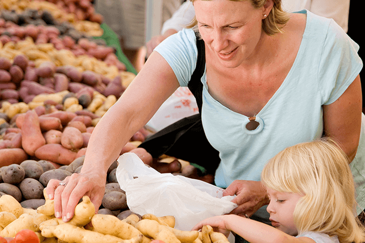 woman at farmers market with child