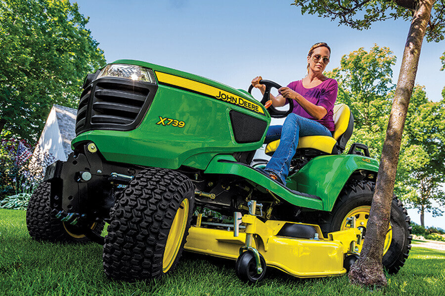 Woman riding John Deere tractor